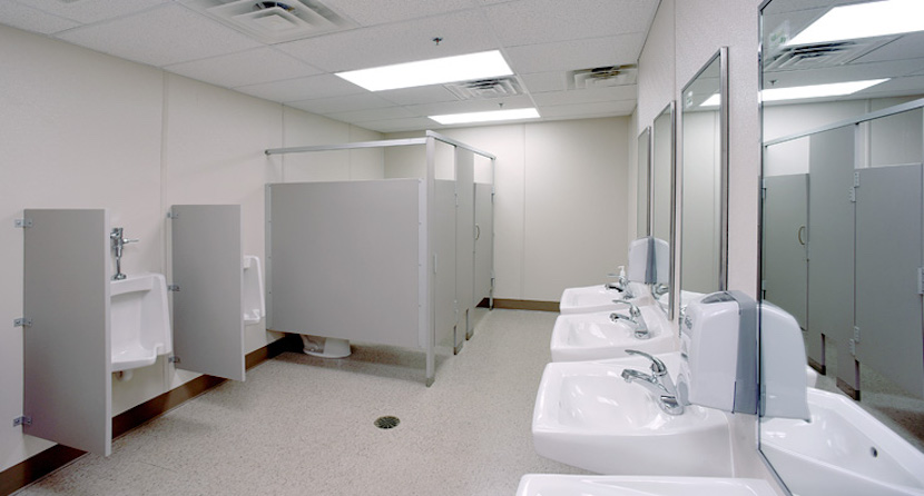 Mens bathroom showing sinks, urinals and stalls