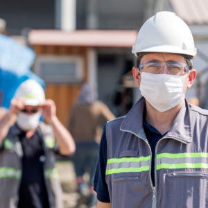 Construction workers wearing face masks